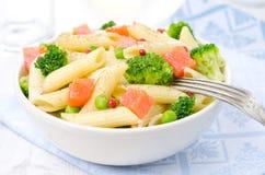 Salad with pasta, salmon, broccoli and green peas Royalty Free Stock Photos