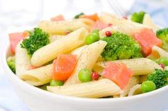 Salad with pasta, smoked salmon, broccoli, green peas closeup Stock Photography