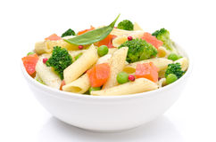 Salad with pasta, smoked salmon, broccoli, green peas on white Stock Images