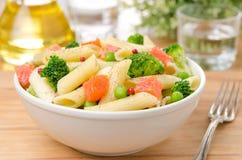 Salad With Pasta Smoked Salmon Broccoli And Green Peas Stock Image