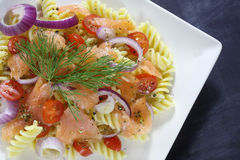 Salad with pasta and smoked salmon Royalty Free Stock Image