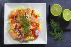 Salad with pasta and smoked salmon Stock Image
