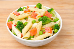 Salad with pasta, smoked salmon, and vegetables Stock Photography