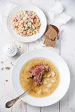Salad and Pea soup. Russian traditional salad olivier and Pea soup with bread and smoked ribs Stock Images