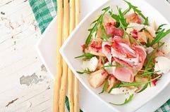 Salad with peach, mozzarella cheese and ham Stock Image
