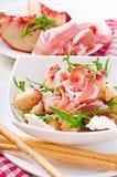 Salad with peach, mozzarella cheese and ham Royalty Free Stock Photo