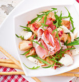 Salad with peach, mozzarella cheese and ham Stock Images