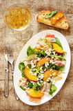 Salad with peaches, bacon; arugula, spinach and goat cheese Stock Photography