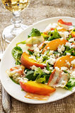 Salad with peaches, bacon; arugula, spinach and goat cheese Royalty Free Stock Image
