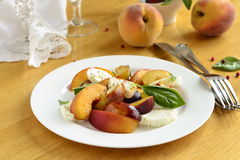 Salad with peaches, goat cheese, plum and basil Stock Photo