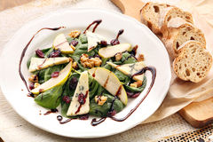 Salad with pear, walnuts and blue cheese Royalty Free Stock Photos