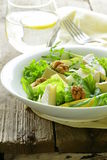 Salad with pear, walnuts and cheese Stock Photo