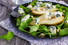 Salad with pears, arugula, blue cheese and pine nuts Royalty Free Stock Image