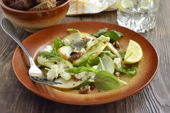 Salad with pears, arugula, cream cheese, walnuts Royalty Free Stock Images