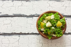 Salad with pears, blue cheese and lettuce. Top view Stock Images