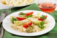 Salad penne, artichoke, tomato Stock Photography