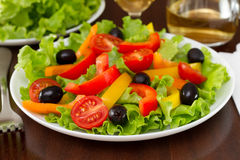 Salad with pepper, olives and lettuce Stock Image