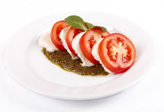 Salad with pesto sauce. Fresh salad from tomatoes with cheese a mozzarella and pesto sautse Stock Photos
