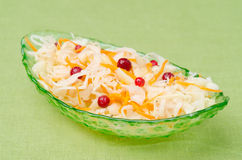 Salad of pickled cabbage with carrots, cowberry in a glass bowl Stock Photography