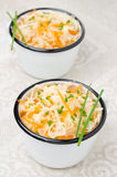 Salad of pickled cabbage with carrots and green onions in cups Stock Photos