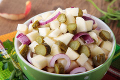 Salad with pickled cucumbers and apples Stock Photos