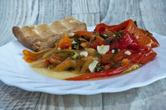 Salad of pickled peppers with garlic, leek and spices Stock Photography