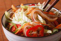 Salad with pig ears and vegetables in a bowl macro. Horizontal Stock Photography