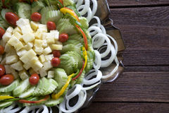 Salad pineapple cucumber tomato wood Stock Images