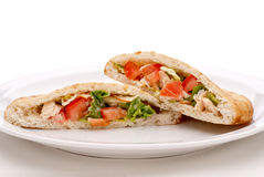 Salad in pita bread on a white plate Stock Image