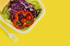 Salad Plastic Box Background / Salad Plastic Box / Salad Plastic Box on Yellow Background Stock Images