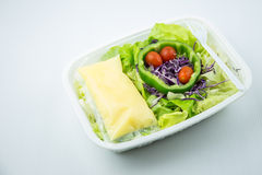 Salad on plastic box. Vegetable salad on plastic box Stock Photography