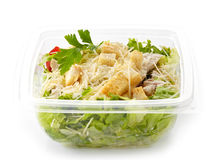 Salad in a plastic take away box. Cesar salad in a plastic take away box Royalty Free Stock Photos