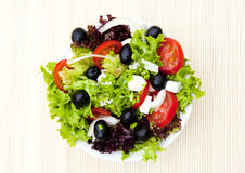 Salad in plate on bamboo mat Royalty Free Stock Photos