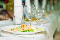 Salad in plate and Cutlery for the Banquet table. A solemn event. Catering.  Stock Photo