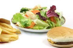 Salad plate potatos burger Royalty Free Stock Images