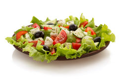 Salad in plate on white Stock Photography