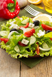 Salad in plate on wood Stock Photos