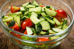 Salad with plenty of cut vegetables on glass bowl Stock Images