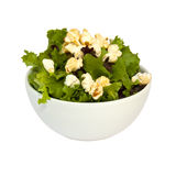Salad and popcorn. Bowl filled with salad and popcorn over white Royalty Free Stock Photos