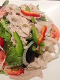 The salad with pork, tomato and onion with japanese sauce Royalty Free Stock Photography