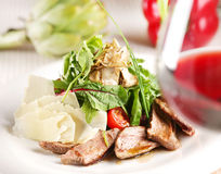Salad with pork, tomatoes and arugula Stock Images