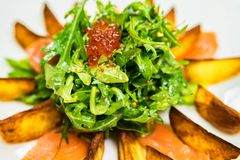 Salad with potato wedges and red caviar Stock Images