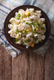 Salad of potatoes, eggs, green onions and mayonnaise. Vertical t Stock Photo