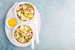 Salad with prawns in bowls on table Royalty Free Stock Photo