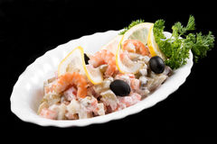 Salad with prawns, fish, potatoes and mayonnaise Stock Photography