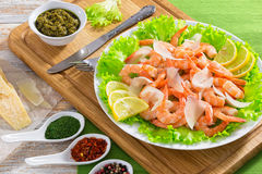 Salad with prawns, lettuce, slices of parmesan cheese and lemon Stock Image