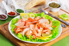 Salad with prawns, lettuce, slices of parmesan cheese and lemon Stock Photography