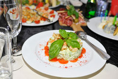 Salad with prawns and mayonnaise. On white plate Stock Photo