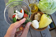 Salad preparation on the summer terrace Royalty Free Stock Photography