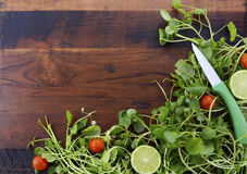 Salad Preparation with Watercess on Wooden Table. Royalty Free Stock Image